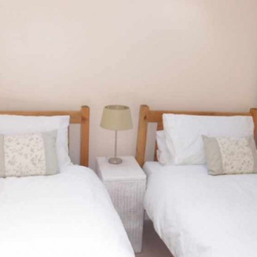 Twin Bedroom inside Self Catering Family Farm Cottage at Heath Farm in Craven Arms Shropshire